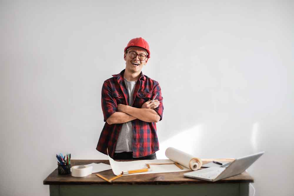 happy construction worker at desk